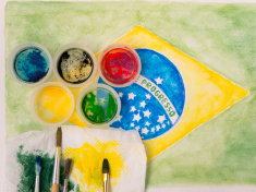 stock-photo-81210979-paints-lids-brushes-and-stained-fabric-on-the-brazil-flag