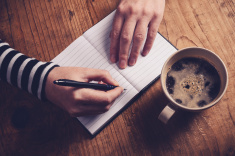 stock-photo-81732177-woman-drinking-coffee-and-writing-a-diary-note