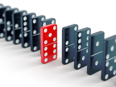 stock-photo-71752311-red-domino-tile-among-black-ones